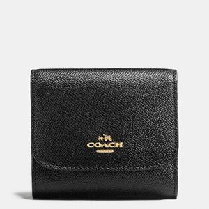 蔻驰 【国内专柜1250元】女士十字纹短款钱包 #LIGHT GOLD/BLACK